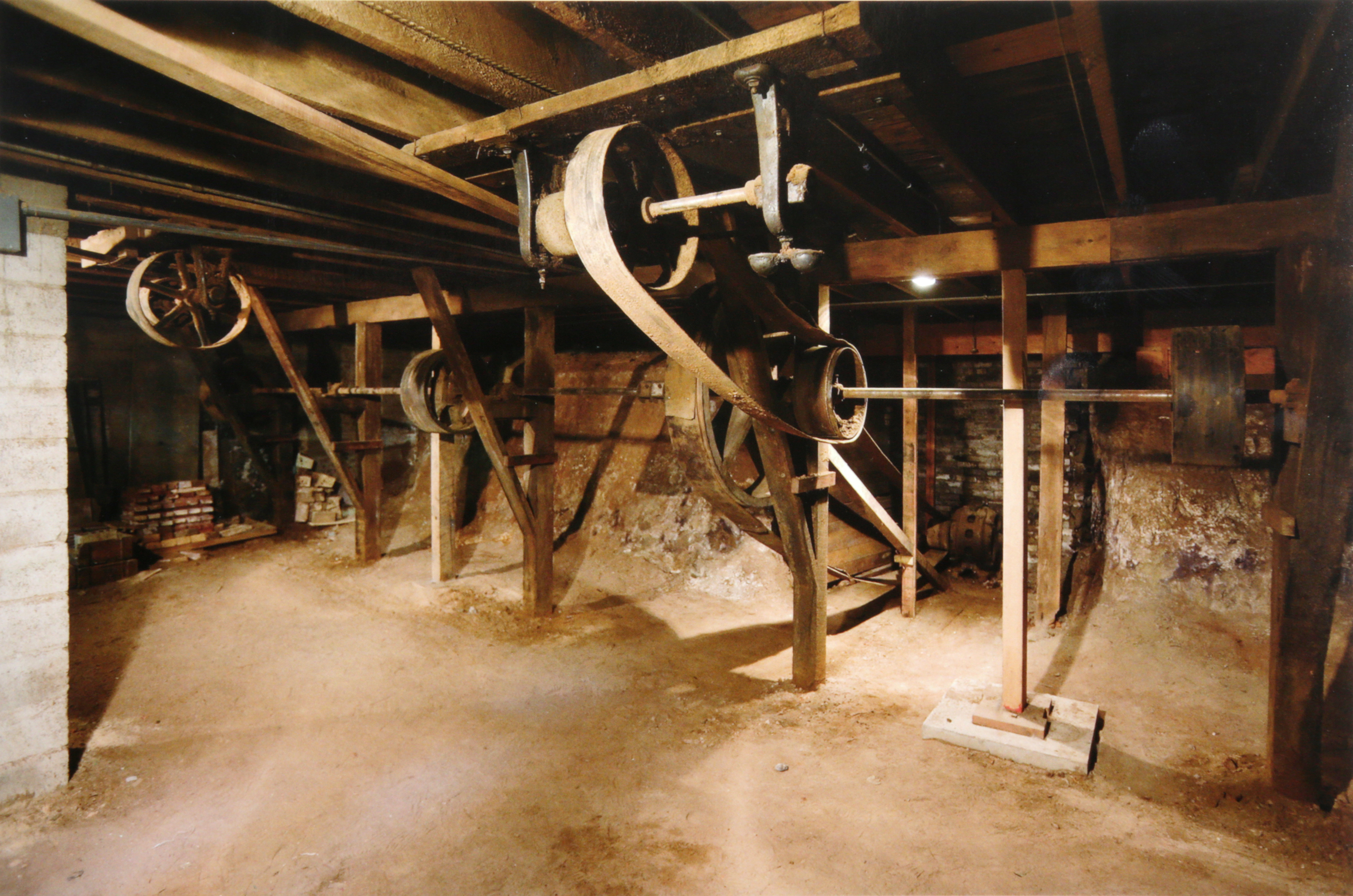 A current photo of the original, river-powered drive shaft from the Johnson Brothers mill. This historic relic is now beneath the floor of the Idaho Falls Cliff Street shop.